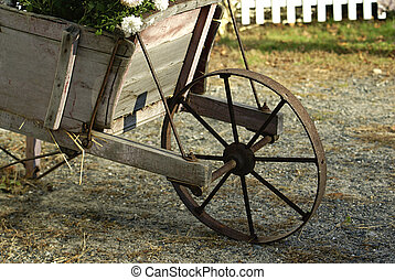 The Cart - a vintage wood cart filled with flowers used as a...