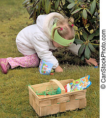 Easter egg hunt 3 - little girl searching for easter eggs in...