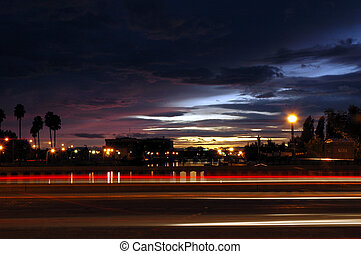 Traffic Light Streaks at Sunset - Light Streaks of Moving...