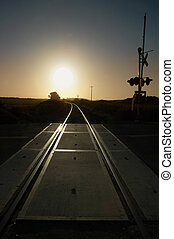 Railroad Tracks and Crossing Signal at Sunrise - Railroad...