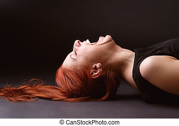 Woman bursts out laughing - Red-haired woman laying on her...
