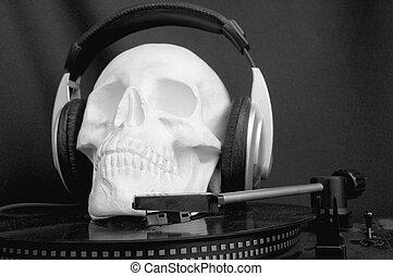 Music Cranium 1 - a cranium with head-phones on a vinyl