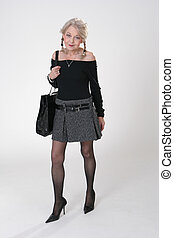 Lady with big bag - Mature Lady in mini-skirt with a big...