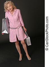 Shopping - Mature Lady with big bags goes shopping