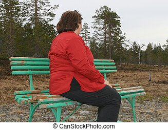 Obese woman - Depressed obese woman sitting on a bench