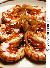 Delicious shrimps cooked with onion and worcestershire sauce