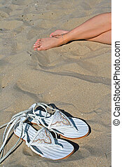 on beach - vacation time on beach with fashion slippers and...