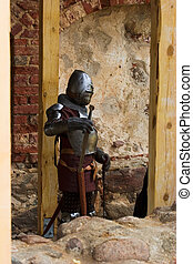 Armoured knight with swords - Armoured knight with sword in...