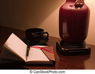 Quiet thoughts - Desk with black cup and saucer, journal and...