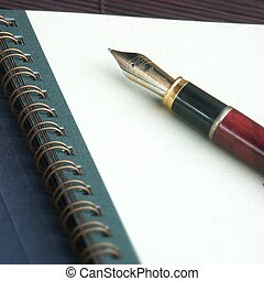 writing - pencil on a white spiral notebook with blanck...