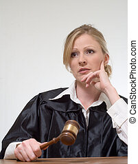woman judge listening - blond woman judge holding a gavel...
