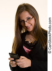 Text messaging - Attractive young brunette smiling business...