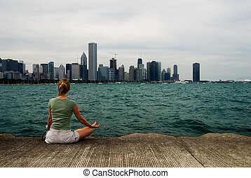 Meditation by Lake Michigan - Young woman doing meditation...