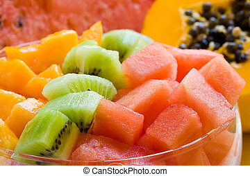Fruit salad - fresh and sweet fruit salad on glass bowl and...