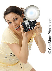 paparazzo - Young beautiful smiling woman holding a photo...