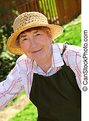 Senior woman - Portrait of a senior woman in gardening apron...
