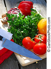 Fresh vegetables - Assorted fresh vegetables on cutting...