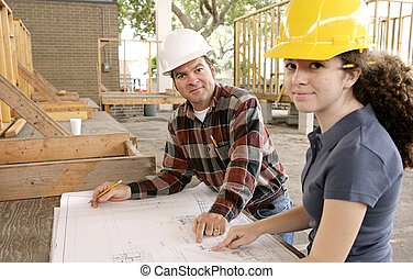 Going Over the Job - A construction foreman going over the...
