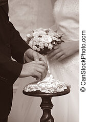 Wedding moment - Hands of the groom and the bride during...