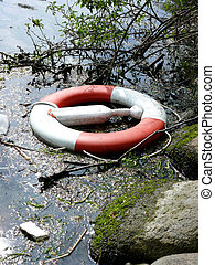 life buoy - portrait of life buoy trown in water