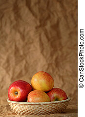 Apples - Yellow and red apples on a beige background