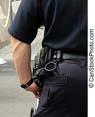 Policeman in Uniform - Detail of Policemans Uniform: Walkie...