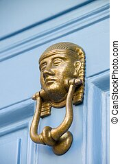 Pharaoh Door Knocker - A brass door knocker in the style of...