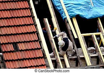 Home renovation - Carpenters working on a roof