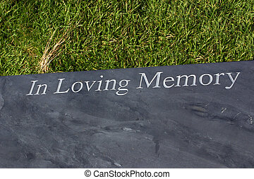 in memory of - memorial stone with the words in loving...