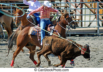 Cowgirl roping a calf in High School Rodeo competition.