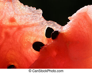 red water melon - Close-up of red water melon against black...