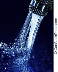 blue water - Faucet with sparkling blue water and lots of...