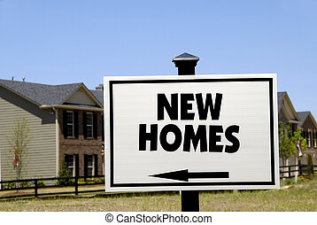 New Homes - Realty Sign advertising New Homes in a...