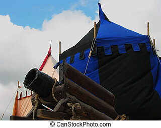 Medieval Gun - a medieval tent and medieval gun and the sky...