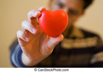 Give you my heart - A young man giving is red hear with love...