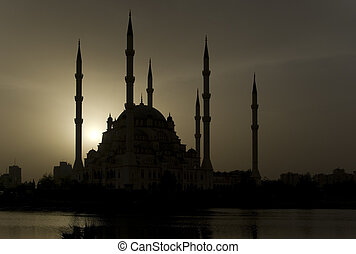 Adana Mosque landscape silhouette against the setting sun.
