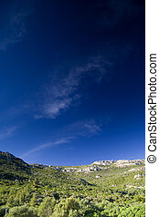 Blue sky over the rocks mountain - big blue sky over the...