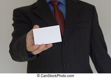 Bussiness man ofering his card (focus on the card)