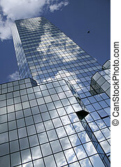 Building - Blue sky and clouds reflected in the glass...