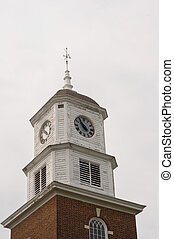 Clock Tower - Clock tower and weather vane on a historic...