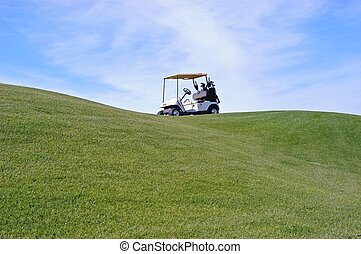 golf cart on golf green with blue sky