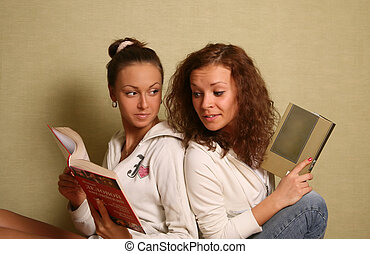 Girlfriends - Two young girls of a house with books