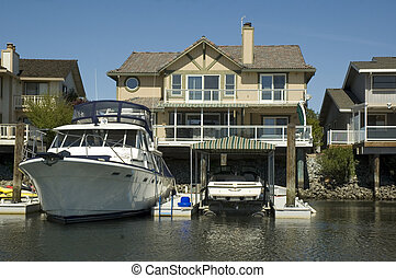 Waterfront home with huge boat in dock - Waterfront home in...