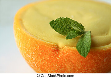 Sorbet - A frozen orange sorbet in its natural shell.