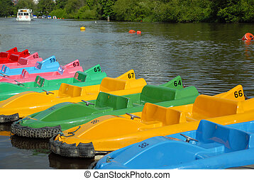 Pedal Boats - Pedal boats of various colours all lined up at...