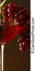 red wine and grapes - glass of red wine with red grapes...