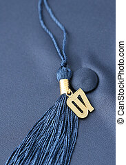 Graduation 07 - Gold 07 tassle on background of blue...