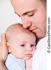 Dad\\\'s love - dad holing and caressing his baby boy