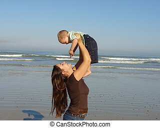 Mother & Child - Mother and son playing on the beach