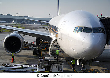 Aeroplane In Transit - Airport maintenance crew checking and...